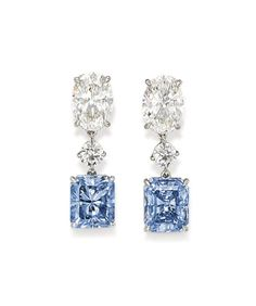 A Rare Pair of Diamond Coloured Diamond Earrings