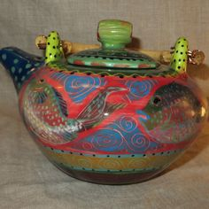 Vivid colors on Asian style fish teapot by pamdesign on Etsy