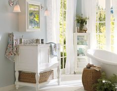 Pottery Barn bathroom. i like the white curtains and light blue wall color