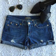 Bebe cutoff jeans shorts Bebe cutoffs jeans shorts- EUC- wear it folded up or down, blue distressed jeans, size 27 bebe Shorts Jean Shorts