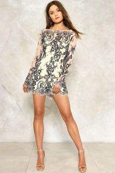 Ace lace. The Jackie Romper comes in lace and features a high neckline, eyelash trim, fitted, mini silhouette, zip closure at back, and sheer mesh detailing.