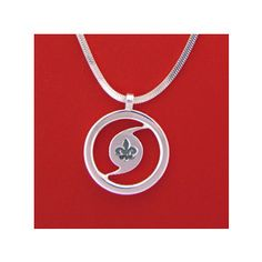 My Hurricane Katrina Anniversary Amulet (by Mignon Faget).  I wear this around my neck ...