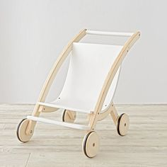 Even the fussiest of dolls will fall asleep after a short stroll in our Mod Doll Pram. It's scaled down for your kid's dolls and designed exclusively for us by Royce Nelson.