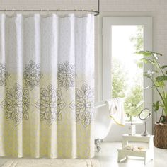 The Tamara shower curtain provides two ways to update your space. Thirteen coordinating curtain hooks feature yellow and grey beads to tie this whole look together.