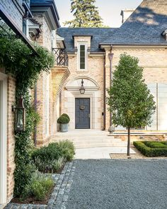The stately entrance to an Anglo-French inspired home by Pursley Dixon Architecture. Landscape architecture by Craig Bergmann. • • • • •… Architecture Courtyard, Studios Architecture, French Architecture, Beautiful Architecture, Landscape Architecture, Traditional Home Exteriors, Traditional House, Traditional Interior, Luxury Homes