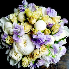 InStyle Weddings: Elan Flowers  The downtown Manhattan florist combines white peonies and cream spray roses with pastel lavender sweet peas for a subtle yet winter bouquet.    Bouquet by Elan Flowers