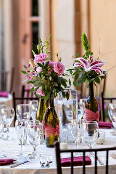 How clever-- wine bottles as centerpieces for a villa wedding? Love it. {B&G Photography}