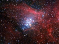 In this amazing space wallpaper from the Wide Field Imager on the MPG/ESO 2.2-metre telescope at ESO's La Silla Observatory in Chile young stars huddle together against a backdrop of clouds of glowing gas and lanes of dust.