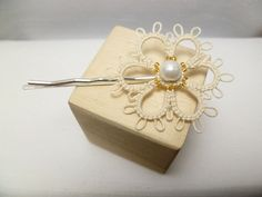 Tatted Sterling Daisy Bobby Pin in soft white with gold glass and large pearl. $6.50, via Etsy.