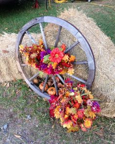 Old Wagon wheels and autumn flowers. Classic
