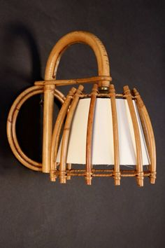 Pair of Rattan Sconces Attributed to Louis Sognot | From a unique collection of antique and modern wall lights and sconces at https://www.1stdibs.com/furniture/lighting/sconces-wall-lights/