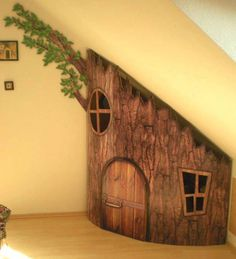 Wooden house under the stairs for kids