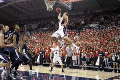 Bringman Young's defense can only watch as Gonzaga's Elias Harris goes for the dunk as teammate Kevin Pangos watches, in the second half of an NCAA college basketball game, Thursday, Feb. in Spokane, Wash. Gonzaga beat BYU 74 to (AP Photo/Jed Conklin) Byu Sports, Gonzaga Basketball, Basketball Games Online, Basketball Playoffs, Basketball Scoreboard, Best Basketball Shoes, Basketball Socks, Basketball Legends, College Basketball