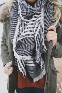 It doesn't get much more classic than this! You can't deny that a scarf is the perfect cold weather accessory. Our Manhattan Blanket Scarf is a black and white striped blanket scarf with raw edges. Im