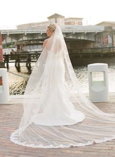 Simple Cathedral Length Veil with Lace Deatailing along Rim.