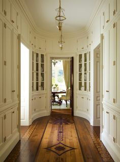 """I love how Cullman & Kravis used stenciling on the floor in the enviable china hall. Its pattern is so complimentary to the millwork and elliptical shape of the room, adding a high country warmth to the formality of the home."""