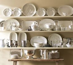 Love this display of white dishes on ledges