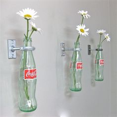 Coca-Cola bottles and curtain rod holders. what a cute kitchen idea!!