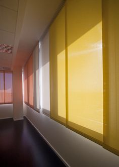 Another means of borrowing light is through translucent surfaces, such as the sliding panels. When they're open, plenty of light spills in, but when more privacy is needed, the light levels are still pretty high.