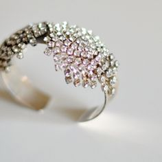 DIY this bracelet using vintage rhinestone earrings... & 10 more easy ways to refashion vintage jewelry.