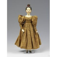 Doll in fashionable dress ca. 1830 Germany Victoria and Albert Museum