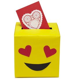 Valentine's Day Card Boxes | To transform a tissue box into your favorite emoji face, you only need three colors of paper: red, yellow, and black.