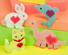 Loving Animals Designed By Ginny Macdonell These sweet creatures wear their hearts right where you can see them! You can create this fun menagerie easily with Perler beads. Decorate a shelf or give one to your BFF as a token of your friendship. Hama Beads Design, Hama Beads Patterns, Beading Patterns, Melted Pony Beads, Perler Bead Templates, Peler Beads, Iron Beads, Beaded Cross Stitch, Beaded Animals