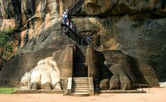 Magnificent: Visitors ascend the stairway to the ancient structure, which contains caves prepared by devotees of the Buddhist Sangha