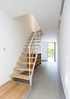 Riganto is a minimalist residence located in Tokyo, Japan, designed by Unico Design Architects. Loft Interior Design, Interior And Exterior, Open Staircase, Stairs, Japanese Modern House, Wooden Cottage, Loft Interiors, Natural Interior, Minimalist Home
