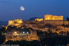 And to all a goodnight: First stop, Athens, and its iconic Acropolis citadel, seen here illuminated in all its glory