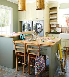 Wanting to keep messy projects out of the kitchen, these homeowners opted to place their crafts area in a laundry room. The upper tier of the custom island provides a place for adults to fold laundry, while the desk below allows kids to create crafts or study.