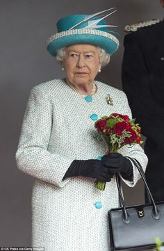 The Queen was resplendent in pale blue for her visit to Lancaster Castle this morning