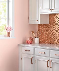 A tin-tile backsplash, matching copper cabinet pulls, and serene pink walls make. A tin-tile backsplash, matching copper cabinet pulls, and serene pink walls make for a charming kit Kitchen Decor Themes, Kitchen Colors, Home Decor, Kitchen Ideas, Kitchen Paint, New Kitchen, Kitchen Corner, Kitchen Tile, Peach Kitchen