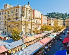 Cours Saleya Market in Nice, France - an outdoor market and a shining example of local color. Home to restaurants and the Marche aux Fleurs, its a short stroll from the beaches and the Promenade des Anglais Nice, Ville France, Provence France, South Of France, Cours Saleya Nice, Cannes, Oh The Places You'll Go, Places To Visit, Places