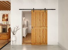 cloison coulissante en bois, sol en parquet gris et poutres apparentes au plafond