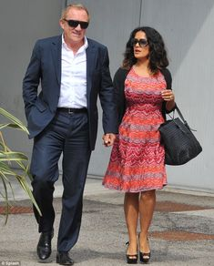 Loved-up: The Oscar-winning actress was accompanied by her husband, Francois-Henri Pinault, as she arrived in the Italian city