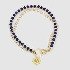 A Lapis Lazuli Bracelet with 24k gold plated goldfilled elements. the stones and beads are threaded on a heavy duty steel wire covered in nylon.