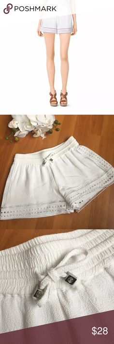 NWOT Michael Kors perforated crepe shorts XXS Michael Kors Perforated Crepe Shorts in White  gorgeous and in perfect condition with no flaws. perforated sides. MK logo metal charms on the drawstrings of the shorts. Michael Kors Shorts