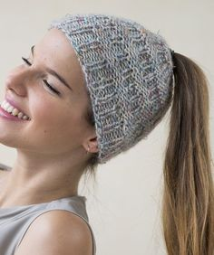 Free Knitting Pattern for Easy Ariana Hat - This easy hat features alternating ribbing and purl and a top opening for messy bun or ponytail. Designed by Filatura Di Crosa Italia. Quick knit in bulky yarn.