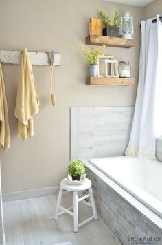 Farmhouse Master Bathroom Makeover. Beautiful shelves over bathtub.
