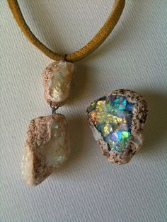 Camille Young - faux opal - Premo, Kato liquid polyclay, iridescent flakes - baked little clumps of iridescent flakes mixed with liquid clay on a piece of glass so they were easy to remove, took cream coloured Premo and stuck the 'opals' all over (rough side up) and textured the surface. After curing mixed some liquid clay with some burnt umber oil paint and wiped the mixture into the rough spots around the opals for a little colour variation and then I gave it a final bake