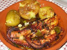 Portuguese food - Delicious Octopus Lagareiro with baked potatoes