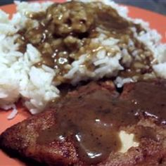 I can see adapting this easily - brown rice or farro instead of starchy less nutritious white rice. Cold  weather comfort food! Chicken with Rice and Gravy Allrecipes.com