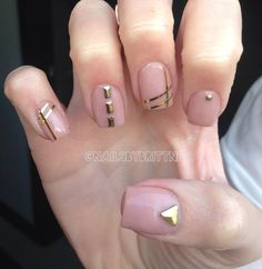 Nude nails with gold stripes & studs