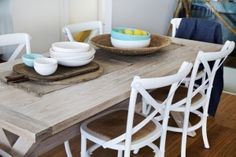 Colours of Summer ☀️Our cross back chairs with rattan padded seat are in stock in white and washed oak $165 each. They are surrounding our locally made blackbutt dining table in a lime finish. Made locally, the timber and wax coat has an incredible feel. #table #Beachwood #locallymade #dining #chair #crossback @batch_ceramics #linen #interiors