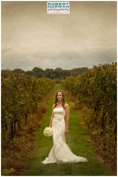 Our bride wearing the 'Carla' gown at her winery wedding in Stonington CT. Photo courtesy of Robert Norman.