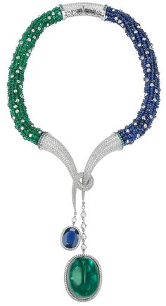 Avakian Cabochon Emerald Necklace-  a 120cts. Cabochon Emerald hanging from a Necklace set with 240 cts of Emeralds, 190 cts of Blue Sapphires and Diamonds weighing 35cts.