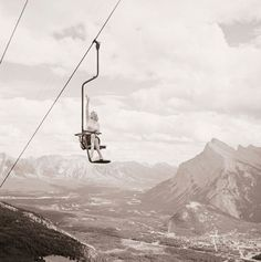 """Marilyn Monroe waving from a chairlift in Banff, Canada. Photographer John Vachon took this shot in the summer of 1953, when Marilyn was recovering from an ankle injury that she sustained while shooting """"River of No Return"""" in the Canadian Rockies."""