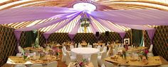 Country Garden theme I Floral Chandelier I Fairy Lights I Lilac Drapes I Wedding I Decorations I The fish eye lens captures most of the beautiful draping inside the 30' yurt I by http://verdigrisvenuedressing.co.uk