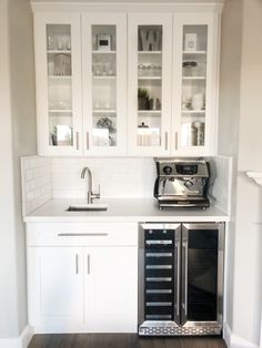 White subway tile, quartz countertops, shaker style cabinets with a stainless steel wine fridge. Modern farmhouse to liven up the living room decor. - Style Of Coffee Bar In Kitchen Coffee Bar Built In, Wine And Coffee Bar, Coffee Bar Design, Kitchen Wet Bar, Coffee Bars In Kitchen, Coffee Bar Home, Wet Bar Sink, Barn Kitchen, Home Wet Bar